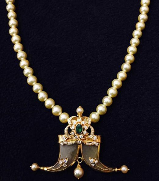 Puligoru necklace | Dhanalakshmi Jewellers